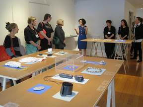 Luiza deCamargo, assistant curator speaking to the group at the Society of Arts and Crafts, Alchemia: An Anthology, Boston, MA.